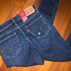 Levi's 711 distressed jeans. Brand new!
